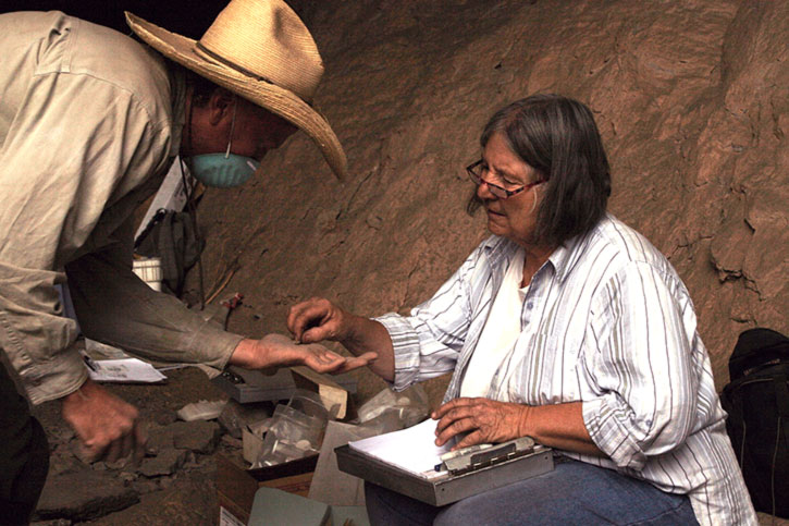 Ann Ohl identifying an artifact