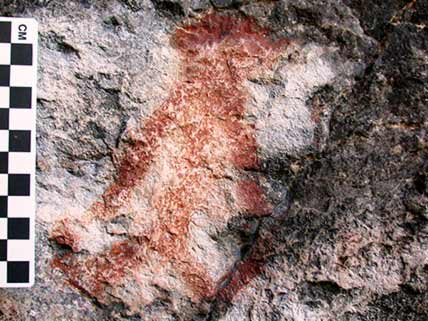 Red figure on rock