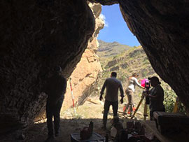 Staff at the mouth of the cave